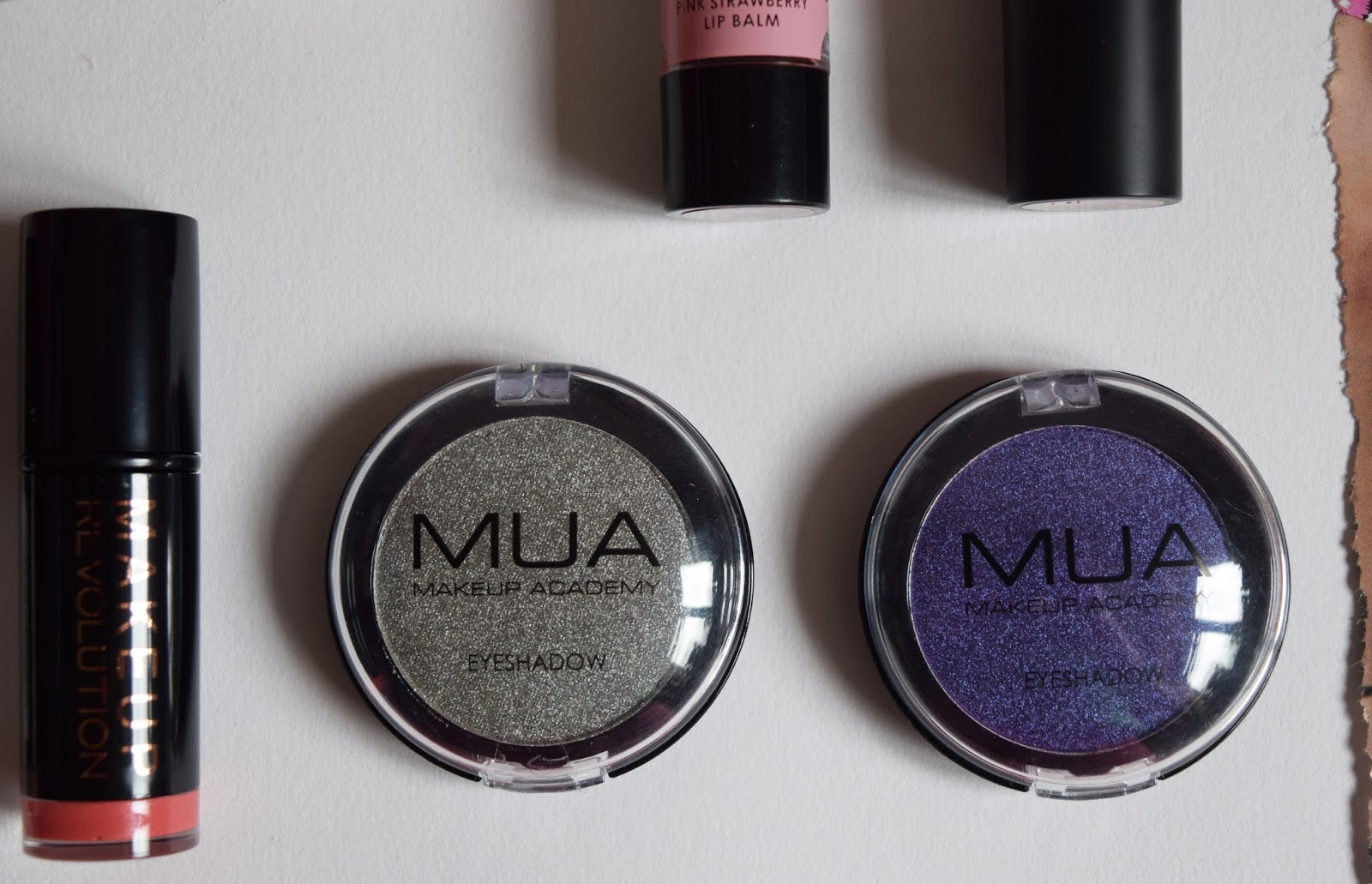 a close up shot of two eyeshadows to be won
