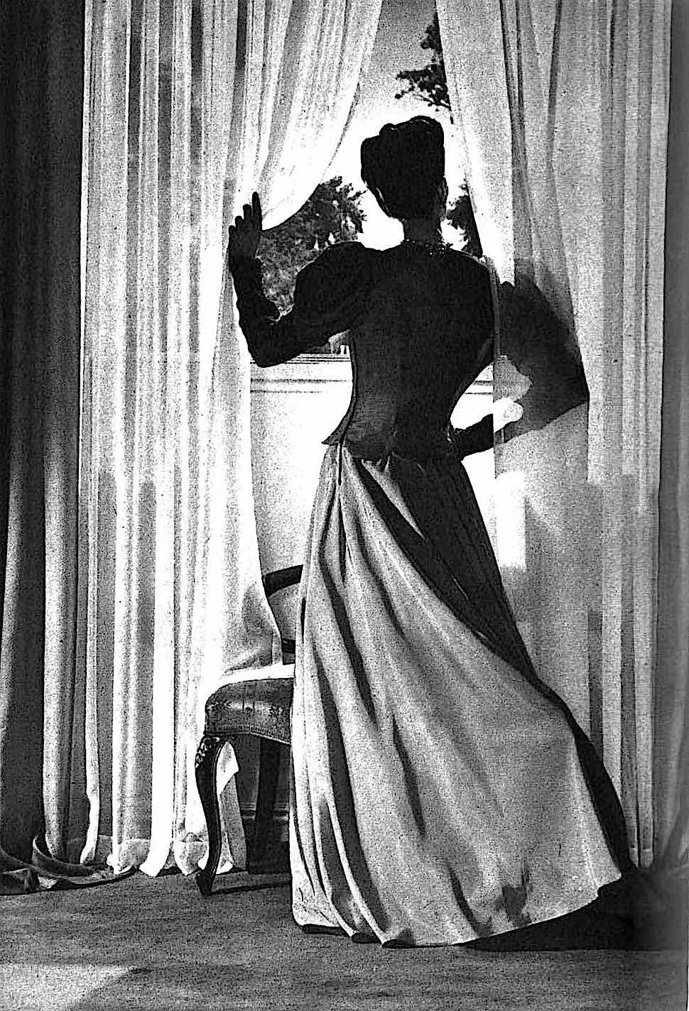 a 1941 noir photograph of a woman at a window