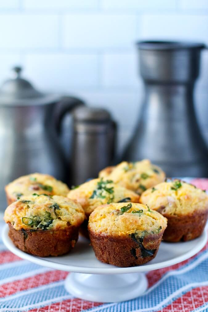 Loaded Breakfast Muffins on a cake plate