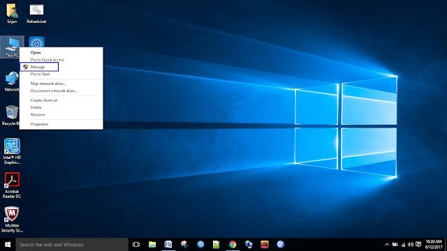 """প্রথমেই """"My Computer""""-এর আইকনে রাইট বাটন ক্লিক করুন । সেখান থেকে """"Manage""""-এ ক্লিক করুন।"""