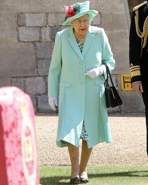 Queen Elizabeth II conferred the Honour of Knighthood on Captain Tom Moore at an Investiture at Windsor Castle in Windsor. turquoise coat