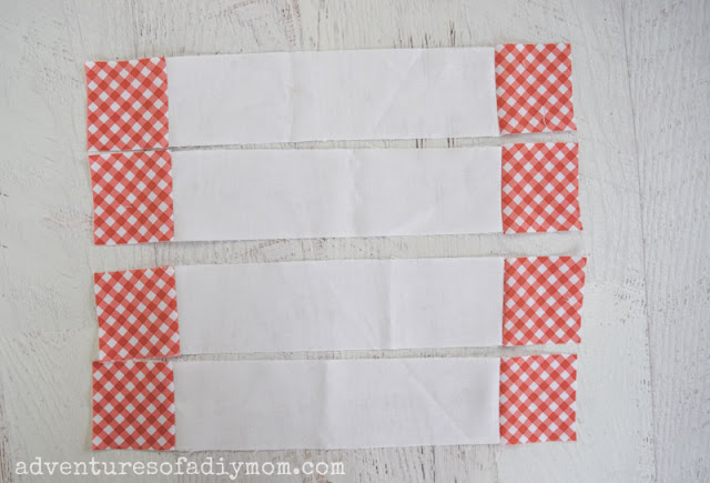 white fabric strips with checkered fabric squares at each end
