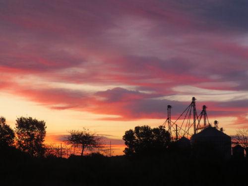 sunrise over grain elevator