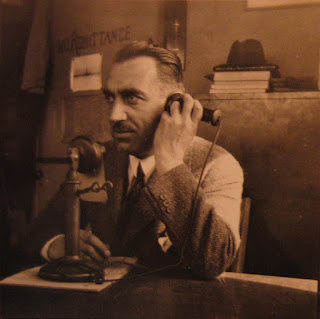 Bossi at his desk in the United States in the 1930s