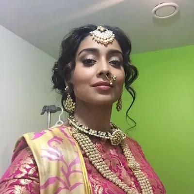 Shriya Saran Wavy Updo Hairstyle