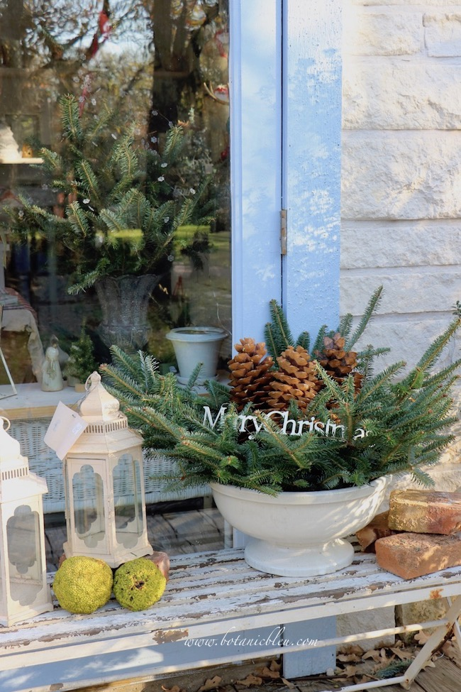 Add a large Merry Christmas sign to the best ever greenery idea for a fresh Christmas wreath
