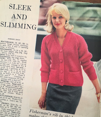 A blonde woman in a chunky red cardigan from 1960