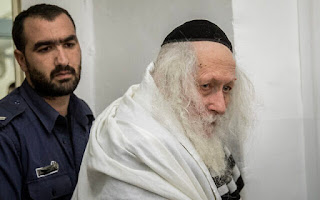 Rabbi Eliezer Berland arrives for a hearing at the Jerusalem Magistrate's Court, on February 13, 2020. (Yonatan Sindel/Flash90)