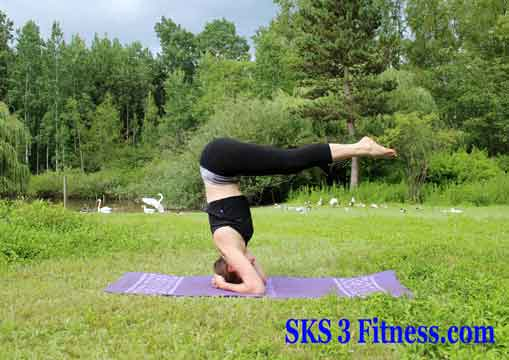 Yoga girl is doing Headstand pose step by step Sirsasana