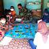 Anggota Satgas TMMD Karanganyar Berikan Bimbingan Belajar Kepada Anak-anak