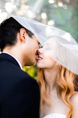 sweet bride and groom kiss