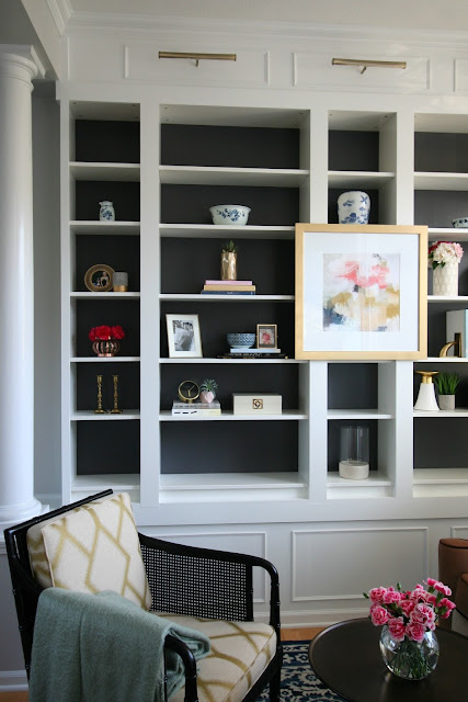 Living Room makeover with custom Ikea Billy bookcase built ins, blush velvet sofa, sherwin williams peppercorn on bookcase, sheriwin williams crushed ice on wall chic living room with picture lights