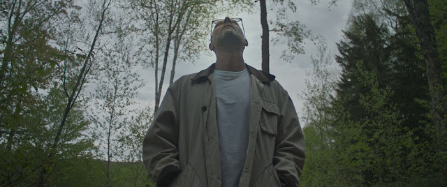 Father stands in forest