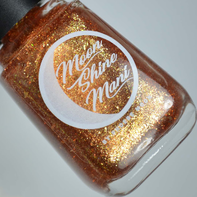 rum gold flakie nail polish in a bottle
