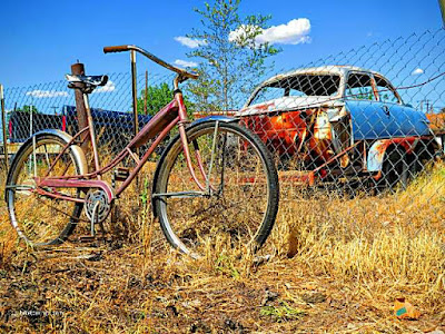 Picture of desert weathered antique bike and car in New Mexico
