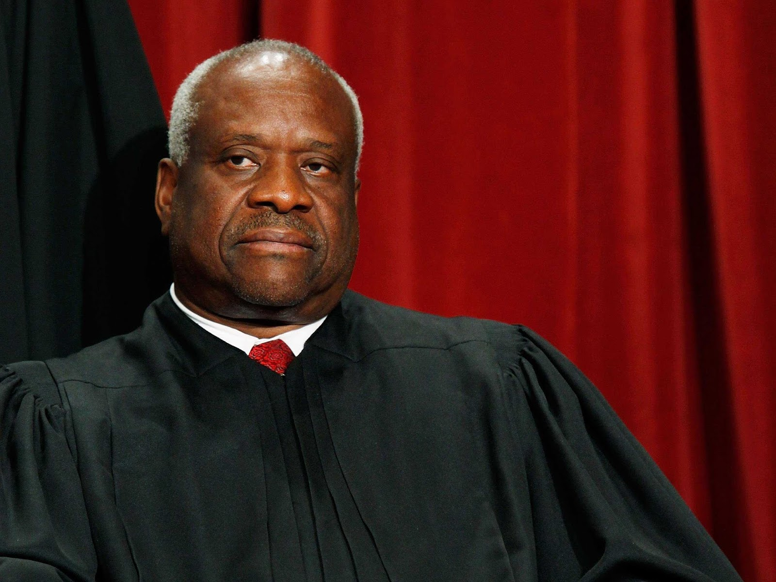racism against justice clarence thomas essay