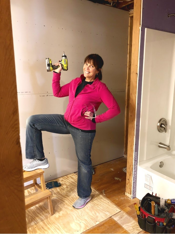 Me feeling accomplished putting up drywall