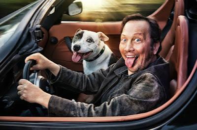 Rob Schneider driving a car