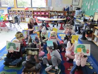Students holding up storybooks.