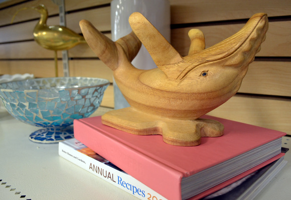 Wooden whale on top of books