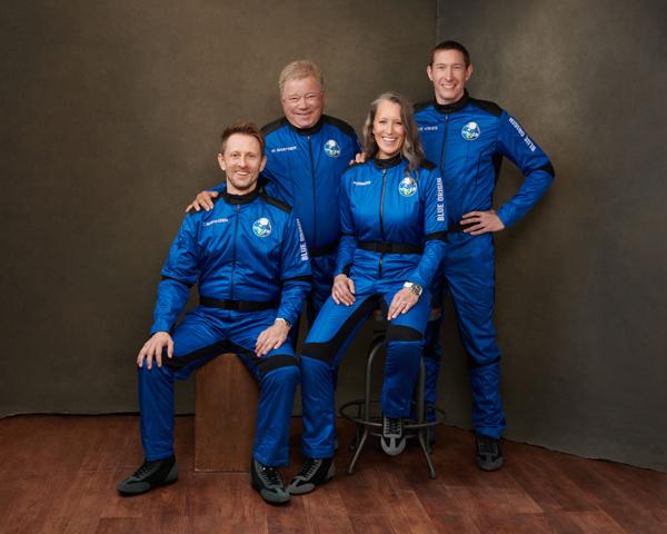 A pre-flight group photo of NS-18 crewmembers Chris Boshuizen, William Shatner, Audrey Powers and Glen de Vries.
