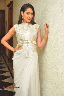 Actress Pragya Jaiswal Stills in Beautiful White Dress at turodu Audio Launch  0018.JPG