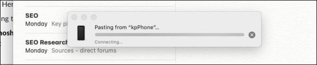 Mac يعرض شريط التقدم للصق صورة من iPhone