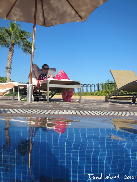 relaxing by the pool, mexico all inclusive resort