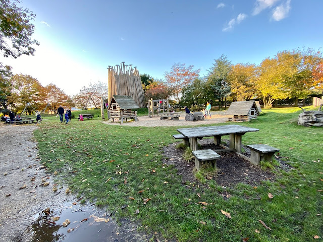 Lots of wooden structures and benches at the play area outside at Pensthorpe bird sanctuary Fakenham Norfolk