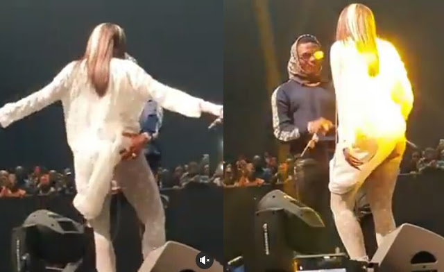 Wizkid Grabs Tiwa Savage's Backside On Stage In Dubai