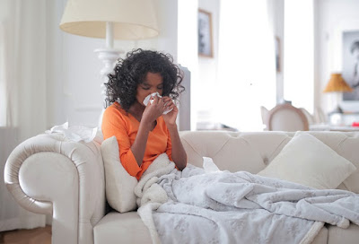 women suffering from fever and cold