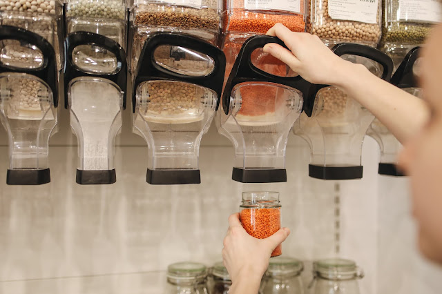 There are a collection of dispensers attached to the wall which allow for you to full up a jar with rice, beans and other ingredients for a zero-waste lifestyle. This is the way forward with shopping