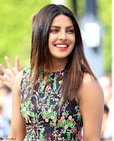 Priyanka Chopra looks super cute in happy mood wearing a short flower print dress in Hollywood 002.jpg
