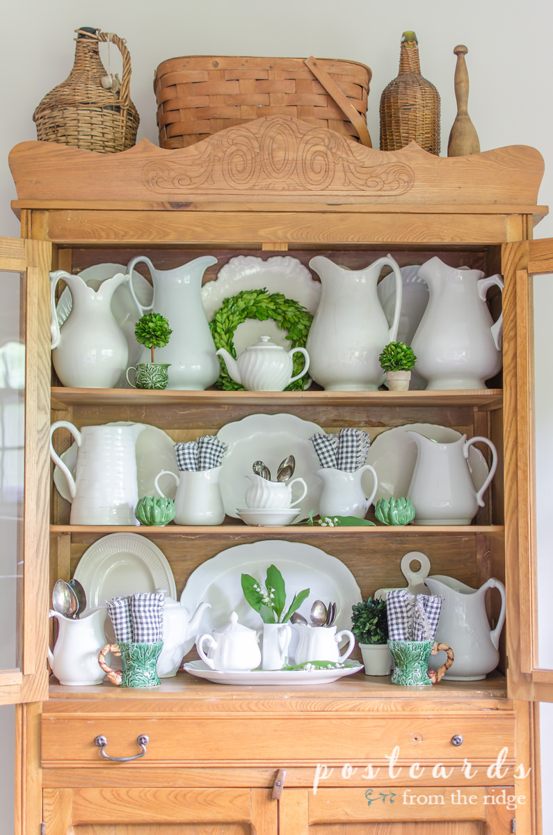 white ironstone with green, black and white in antique oak hutch