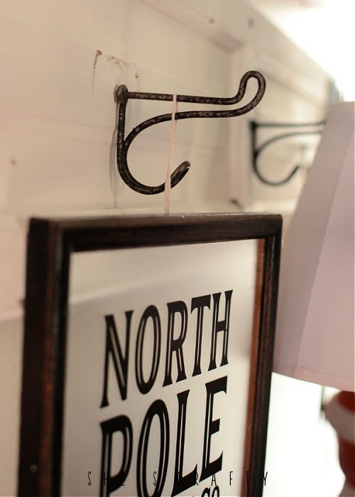 Vintage screw in hooks to hold sign in Christmas vignette