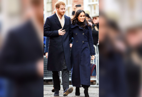 Prince Harry, Meghan Markle that are standing in the street: Prince Harry and Meghan Markle visit a Terrence Higgins Trust World AIDS Day Charity Fair at the Nottingham Contemporary in England on Dec. 1, 2017.