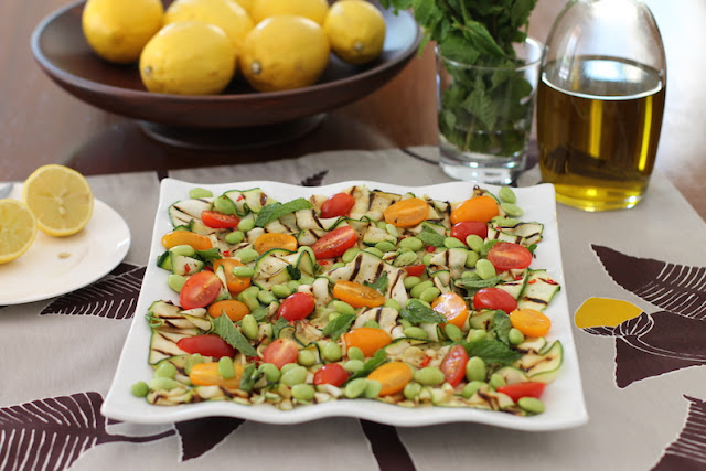 Food Lust People Love: Grilled zucchini summer salad is beautiful and tasty, the perfect plate of cheap and abundant zucchini and ripe grape tomatoes. Throw a few edamame on there for color and protein! It's a great side dish or even main course for hot summer nights.