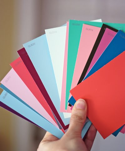 To make this fancy paint chip art cut swatches into triangles. I found it easiest to trim the swatches into strips first then cut the angled sides using ... & How to make easy paint chip wall art   How About Orange