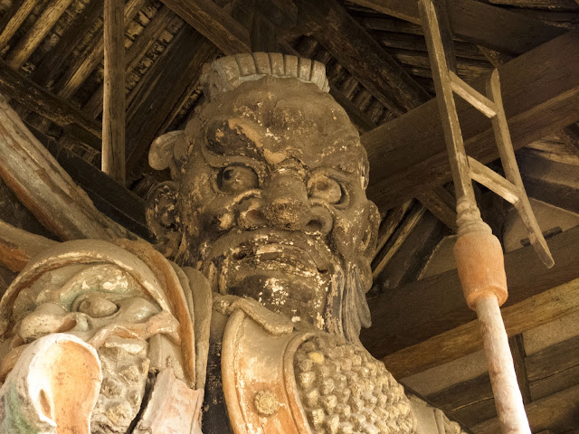 Stern-faced god at a temple in Pingyao, China