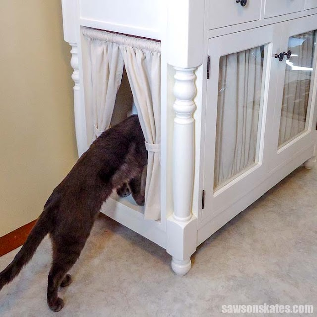 hiding cat litter with fabric curtains under table