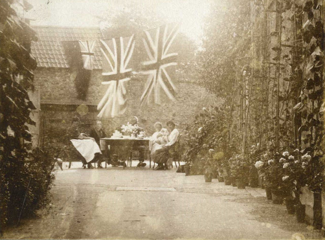 Union Jack flags flying above a table set for tea