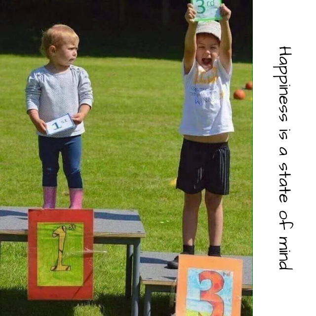 The boy who is standing at the first position is not happy and the boy who is standing on the third position is very happy.