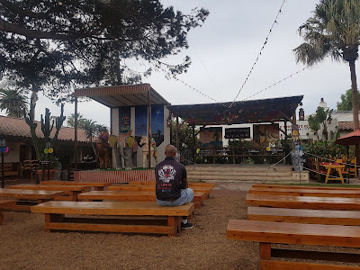 Tim sitting on a bench in front of an empty stage