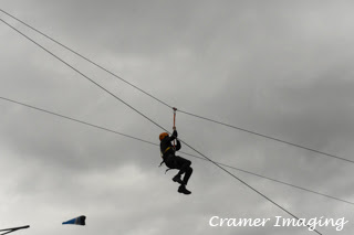 Cramer Imaging's photograph of an outdoor enthusiast on a zip line against the sky in Firth, Idaho