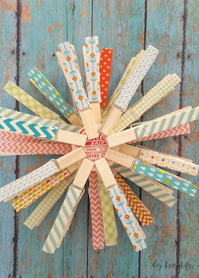Learn how to create stunning snowflakes from washi tape and clothespins! Visit diy beautify for the tutorial!