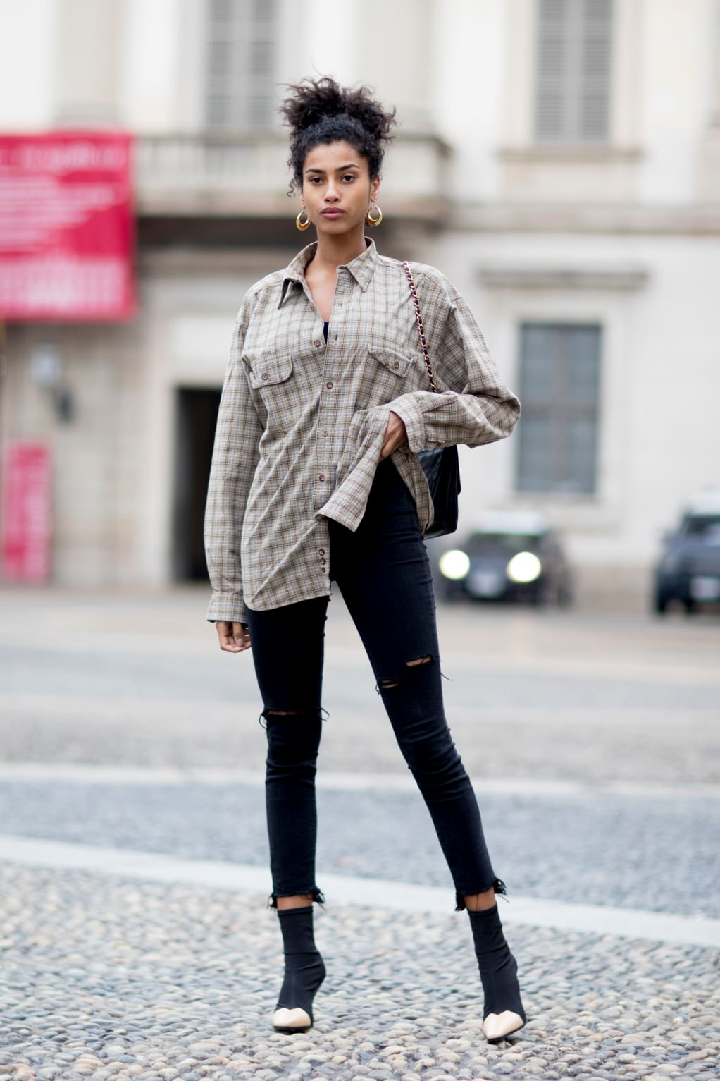 25 Best Plaid Shirts — Casual Cool Fall or Winter Outfit Idea — Model Street Style Imaan Hamman in a neutral plaid button-down, ripped black skinny jeans, and ankle boots
