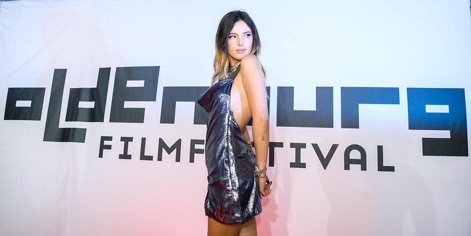 Bella Thorne goes backless and braless for the Oldenburg Film Festival
