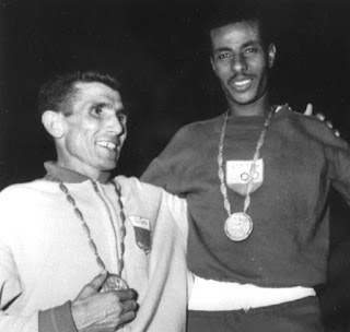 Bikila on the podium with runner-up Rhadi Ben Abdesselam