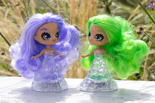 Amethyst and Adventurine Crystalina dolls next to each other
