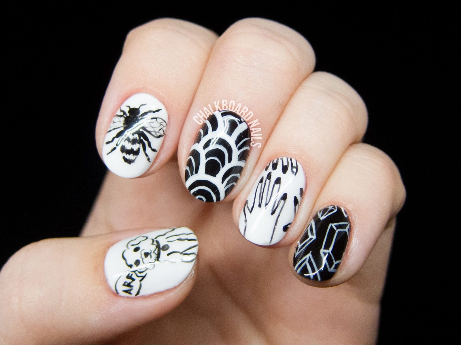 Freehand black and white nail art @chalkboardnails